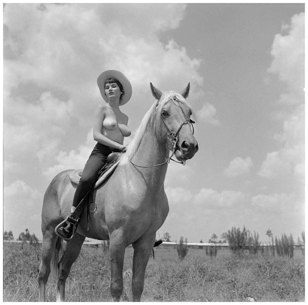 Bunny Yeager topless on horse film photo