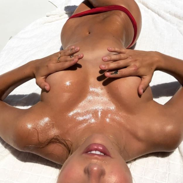Falling in love with a half naked, oiled up and all shiny beauty queen Alexis Ren while tanning topless in the sun